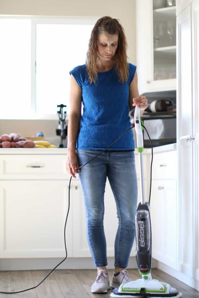 Woman about to mop her floor