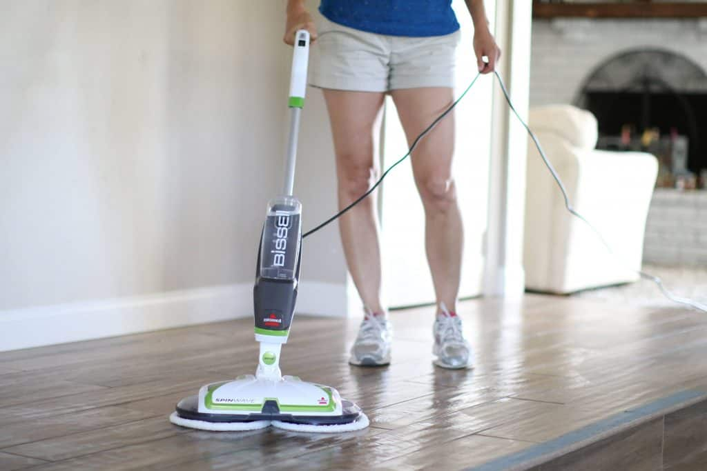 Woman mopping her floors