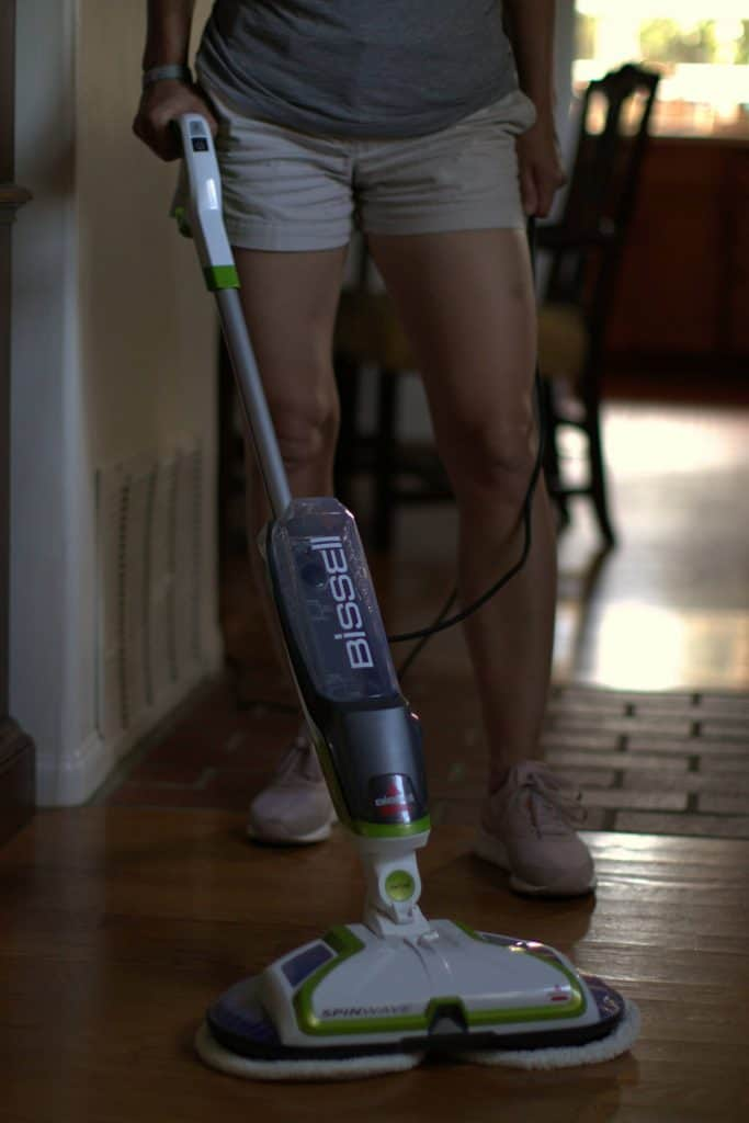 Woman using a mop to clean her floors