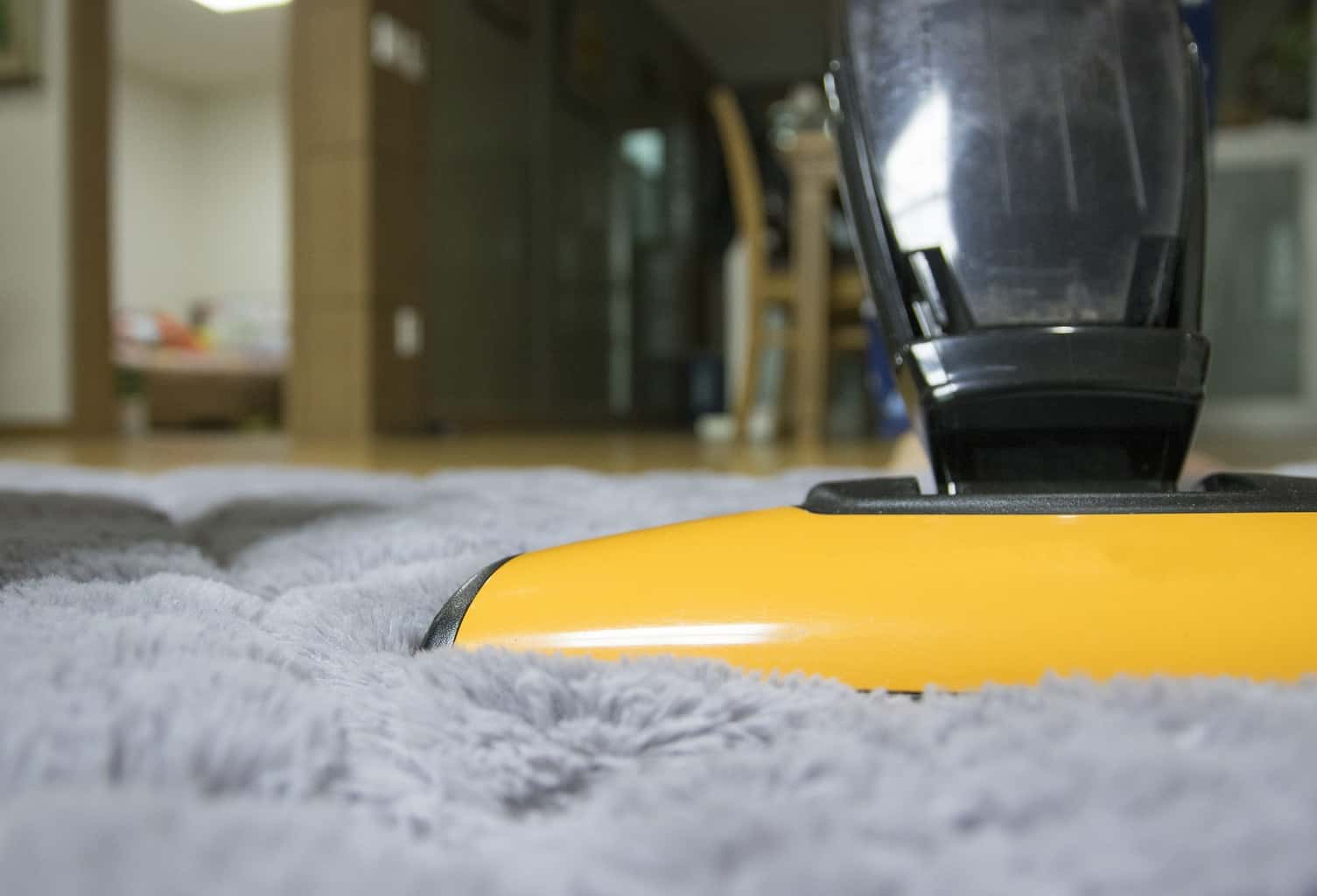 Vacuum cleaning a carpeted floor
