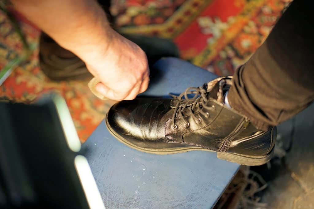 Person wearing used shoes having it cleaned professionally