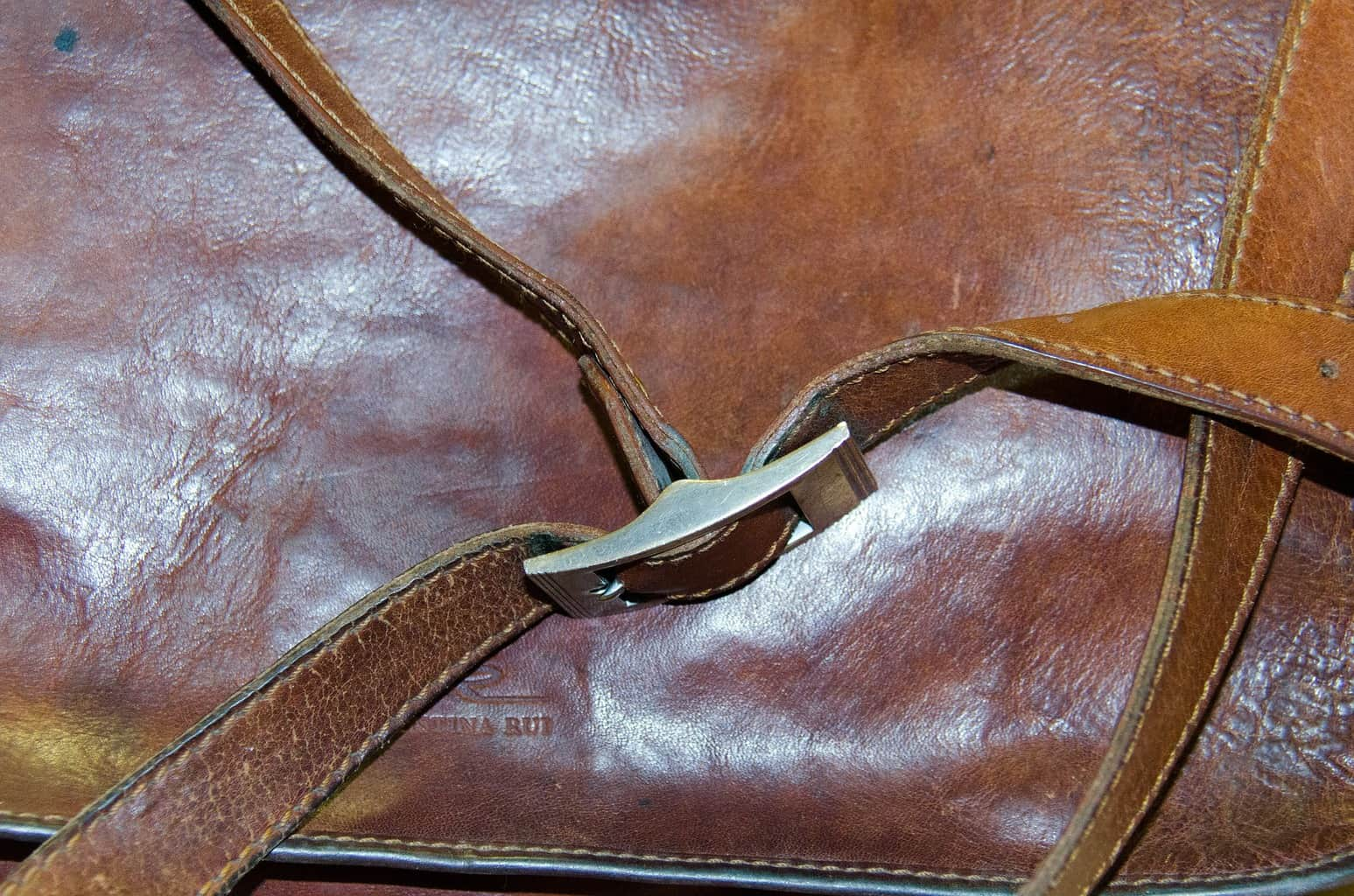 Water stain from leather bag in need of cleaning