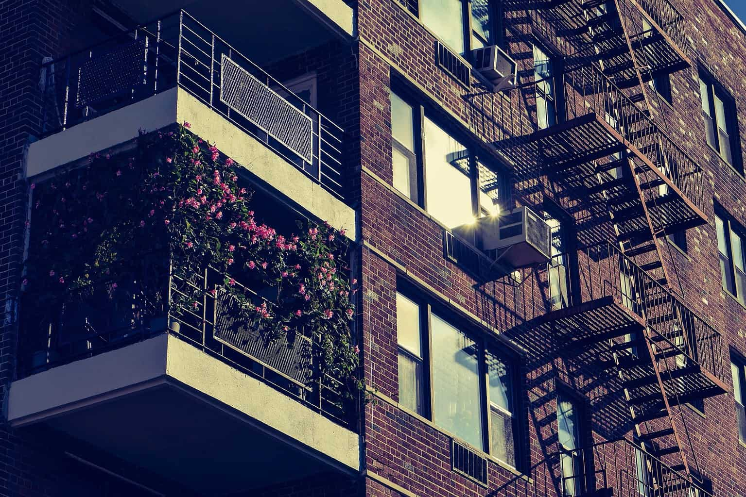 Exterior of an apartment building with window air conditioners
