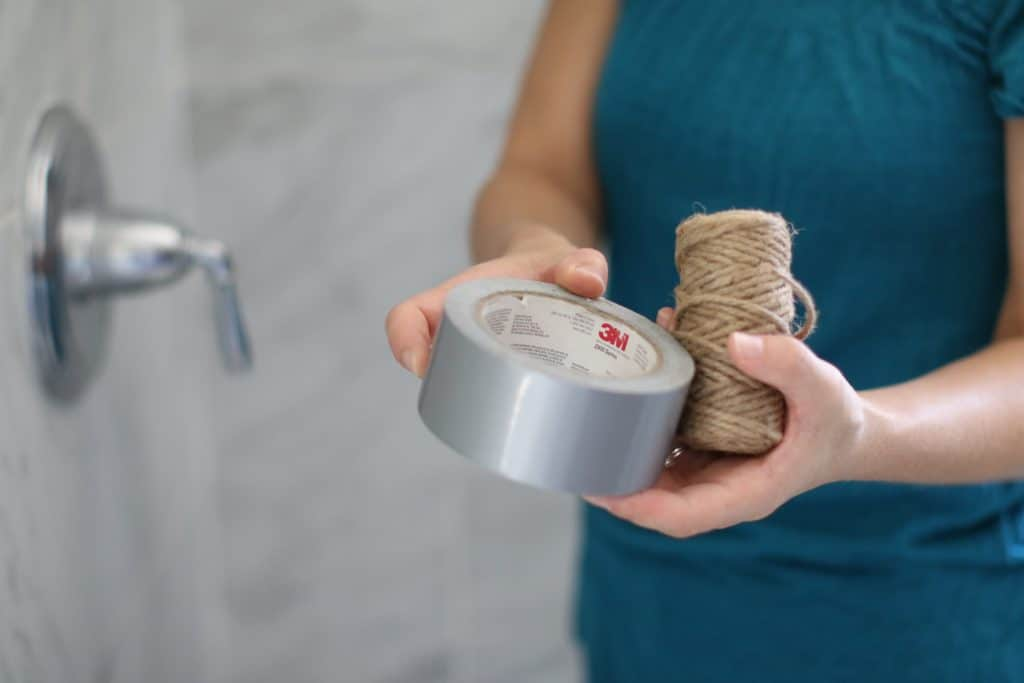 Person holding a duct tape and twine