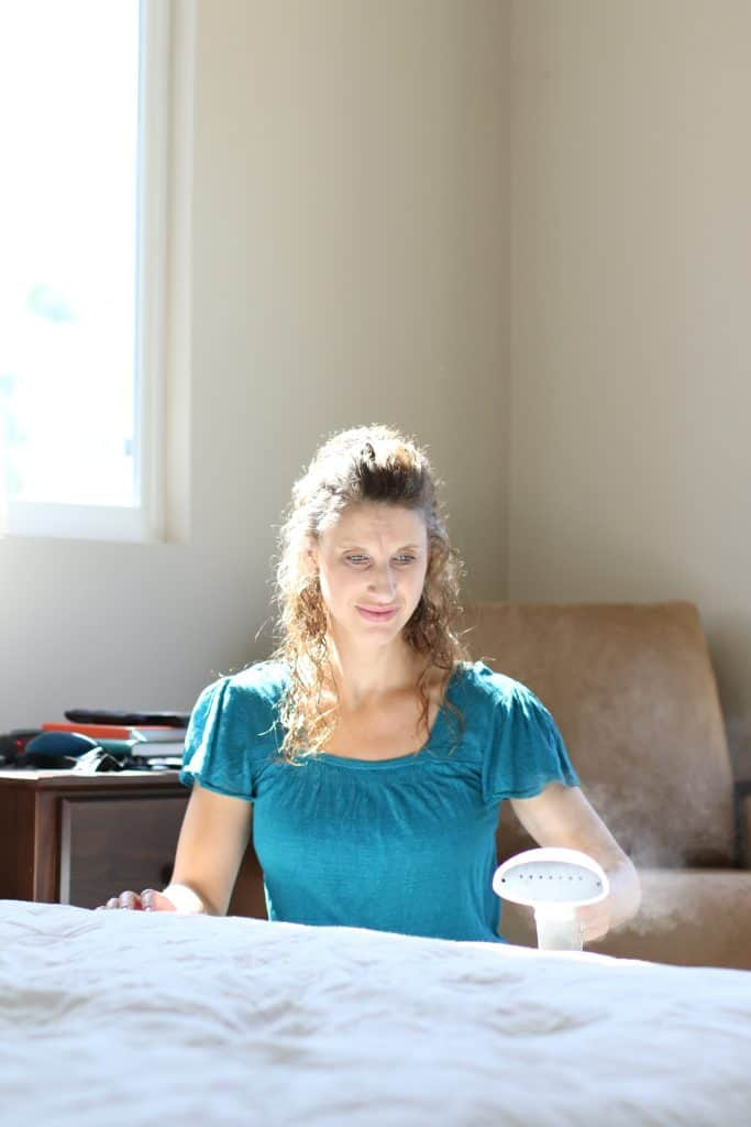 Woman steam cleaning her mattress