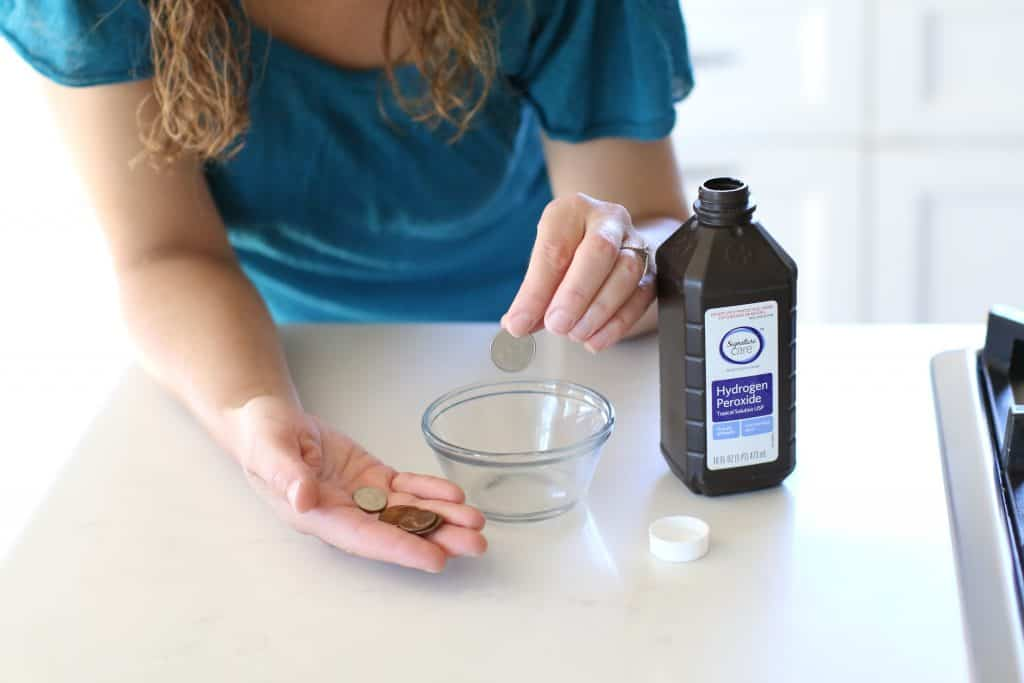 Woman cleaning her coins with a hydrogen peroxide solution
