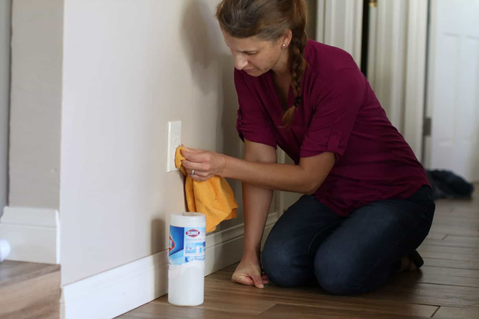 Woman cleaning an electrical outlet