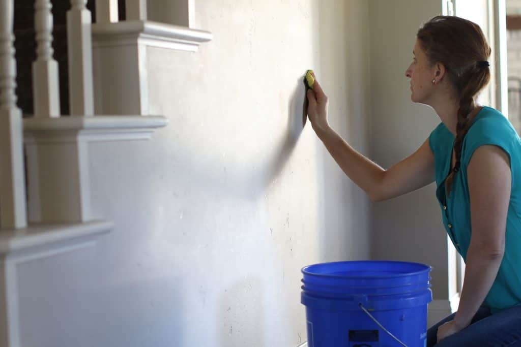 Woman cleaning her walls