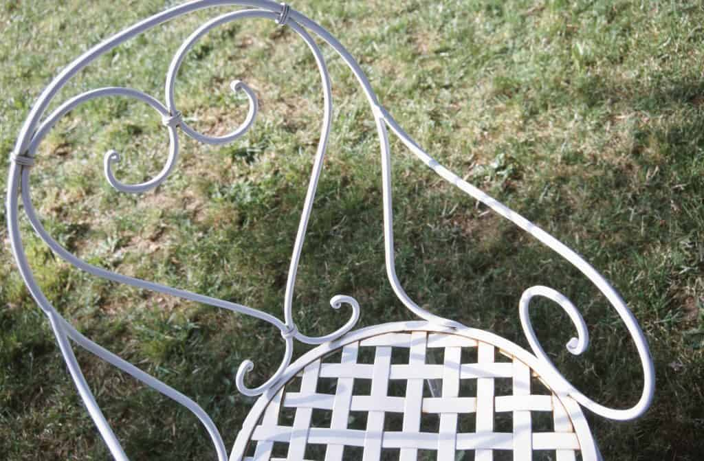 Wrought iron chair outdoors on lawn