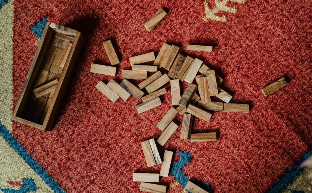 Toy blocks scattered on carpet