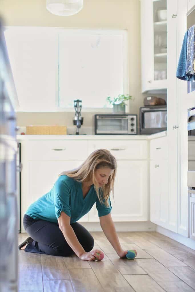 Woman cleaning her hardwood floors