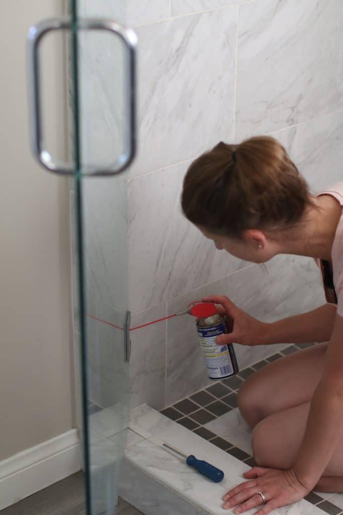 Woman fixing shower door