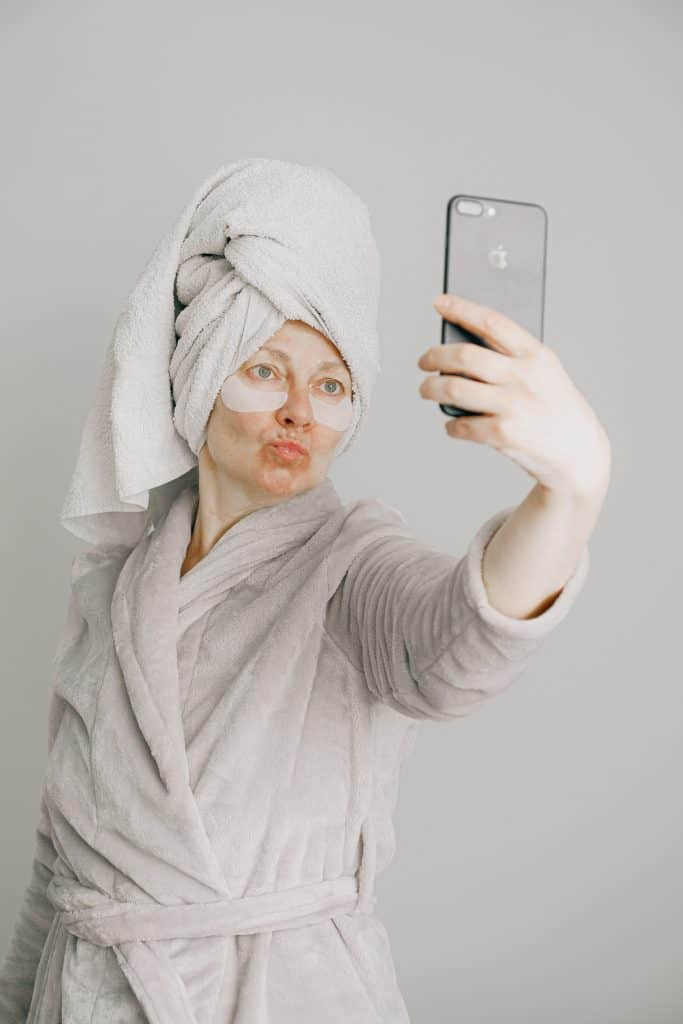 Woman taking a selfie after taking a shower