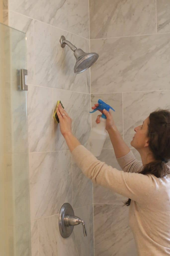 Woman cleaning her shower