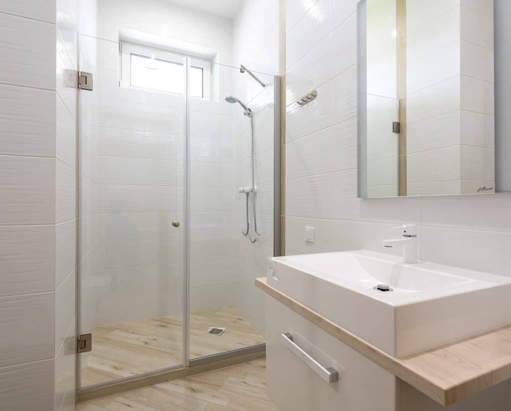A bathroom with glass doors in the shower