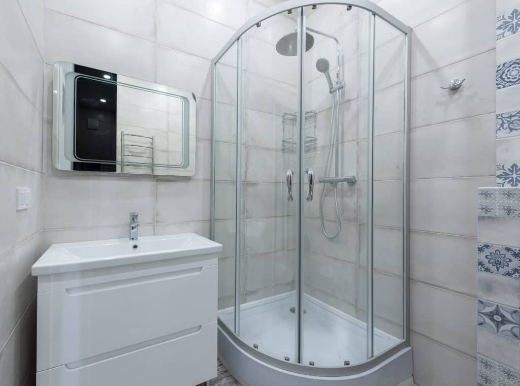 A shower cabin with glass door and window