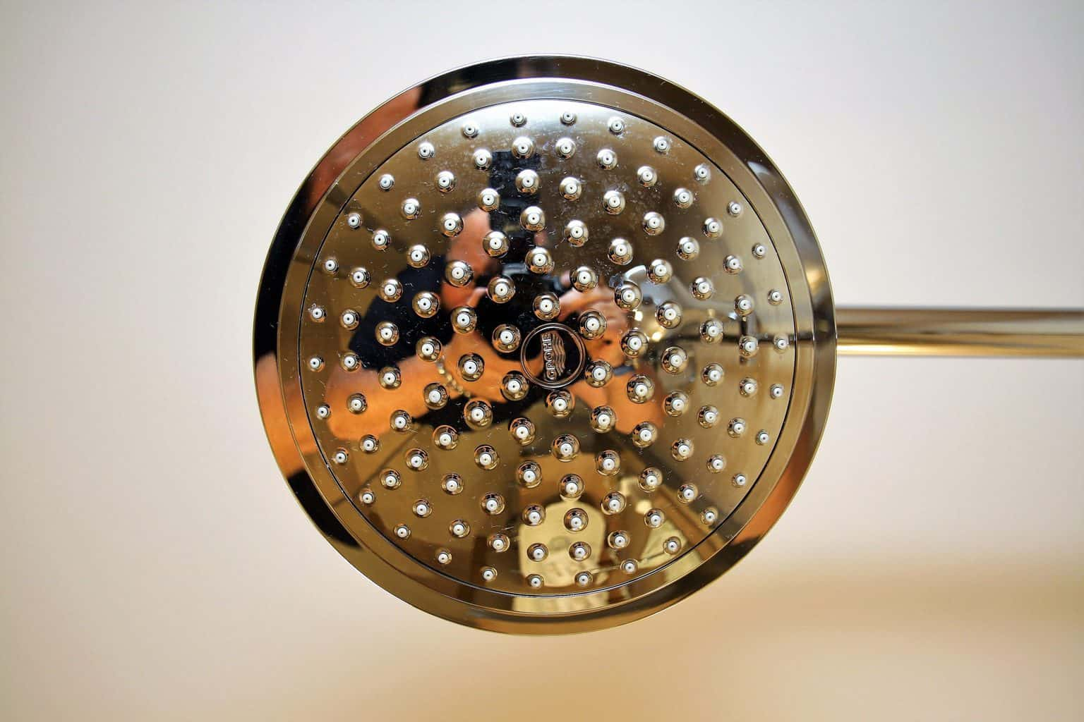 A gold toned shower head