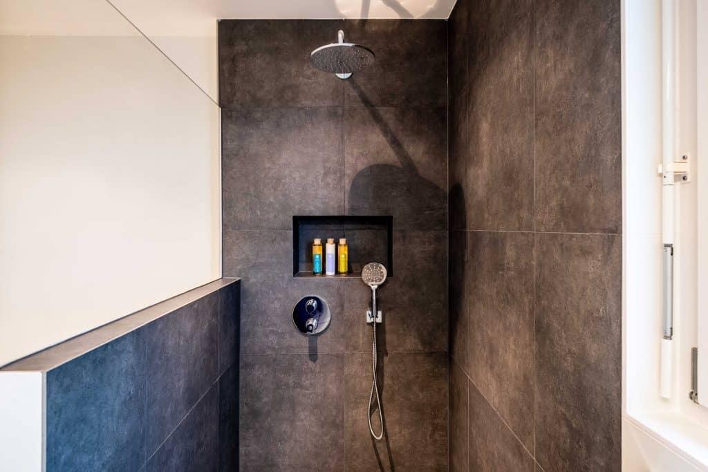 A bathroom walkin with slate tiles