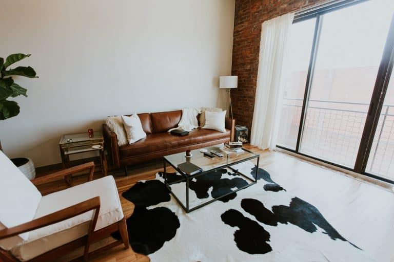 A cowhide rug in a living room