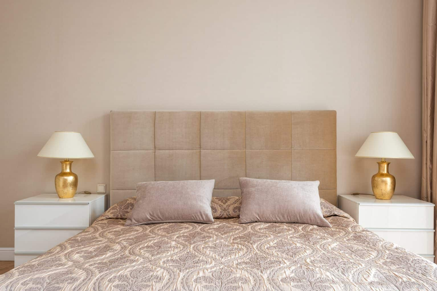A brown toned bed with a headboard