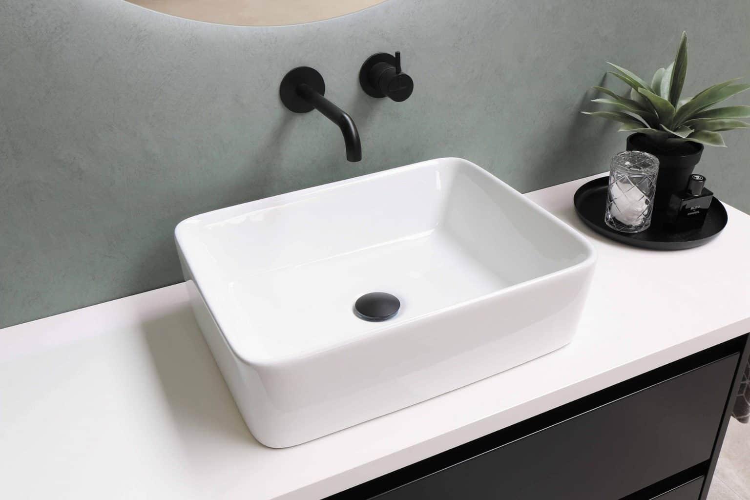 A simple fiberglass sink with black faucet
