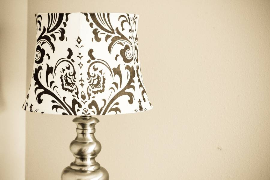 A fabric lampshade with a printed design