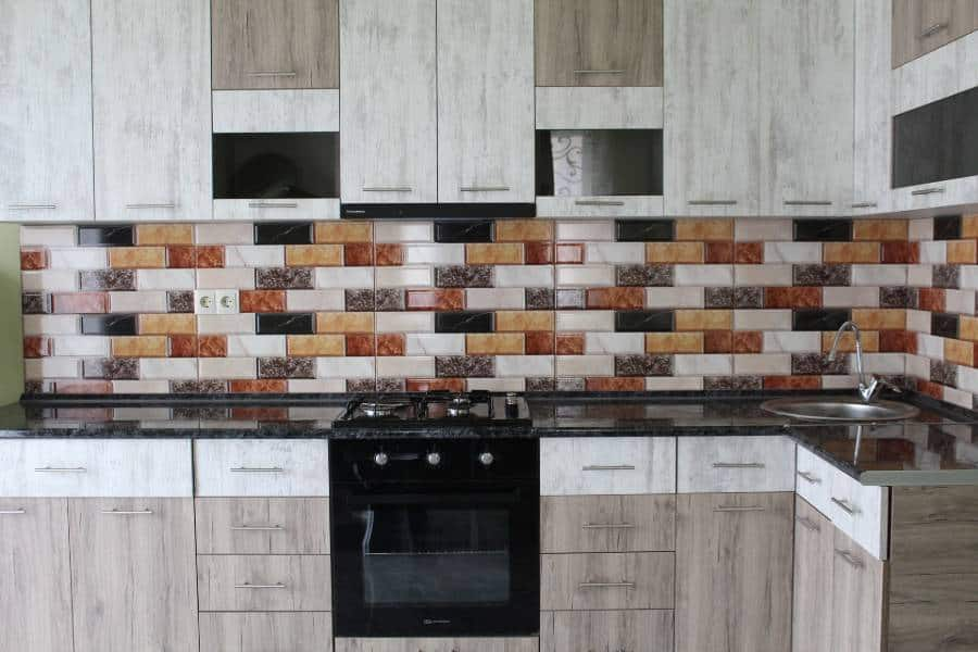Full kitchen with tile countertop