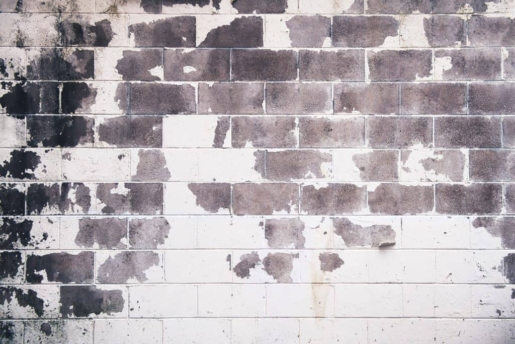 A faded and eroded painted bricks