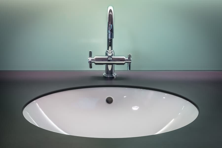 Bathroom acrylic sink with shiny faucet