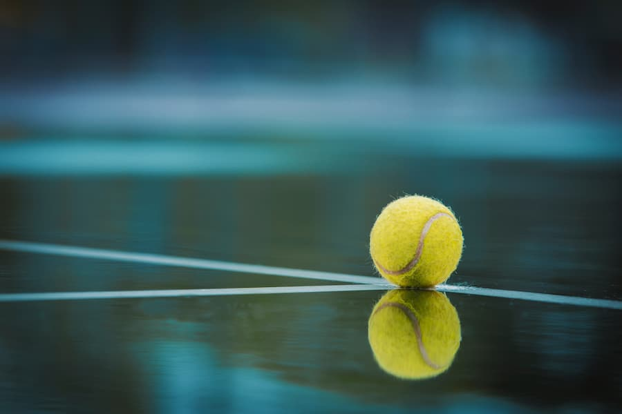 Tennis ball with reflection and bokeh effect